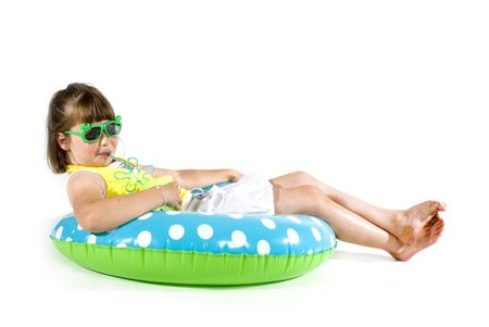 swimming girl with a cup of lemonade Stock Photo - 966481