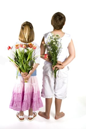 kids are giving you flowers by surprise photo