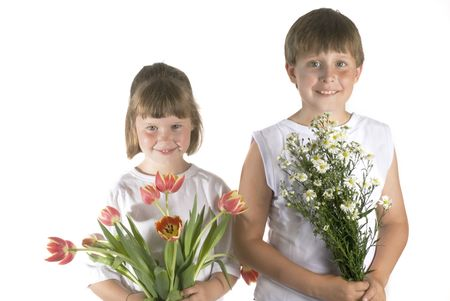 boy and girl are giving flowers as a surprise photo