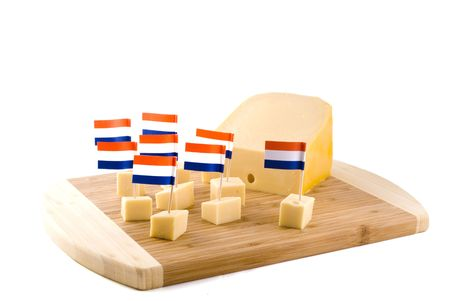 Dutch cheese cubes on a wooden board Stock Photo - 1298774