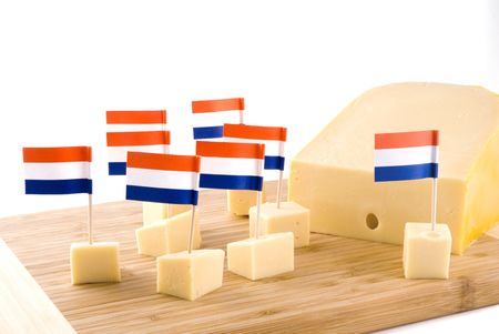 butterfat: Dutch cubes from cheese on a wooden plate