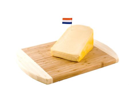 a big piece of Dutch cheese with a flag on it photo