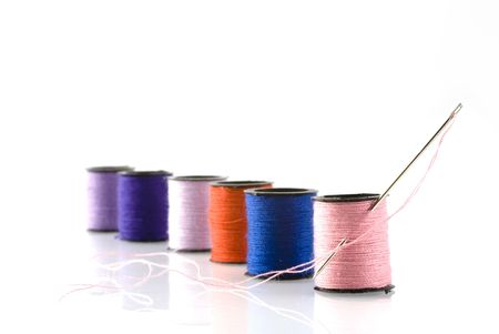 needle-work in different colors threads photo