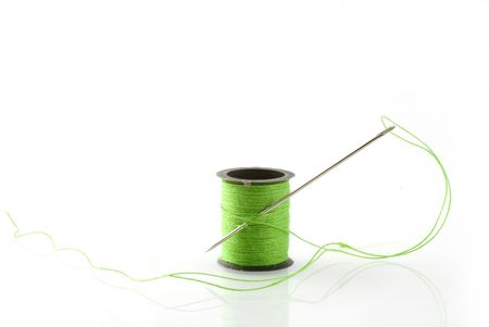 green thread on a spool with needle Stock Photo - 1328785