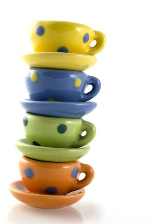 Pile of colored cup and saucers with dots Stock Photo - 1328793