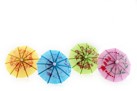 tropical parasols in different colors Stock Photo