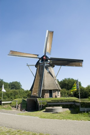 Dutch wind-mill in Holland used for corn Stock Photo - 1414513