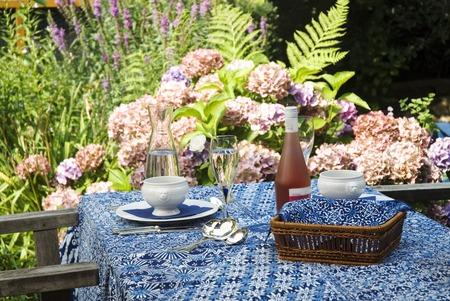 dinner for two outdoor in the flower-garden Imagens