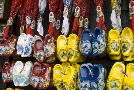 a wall full of painted wooden shoes from Holland photo