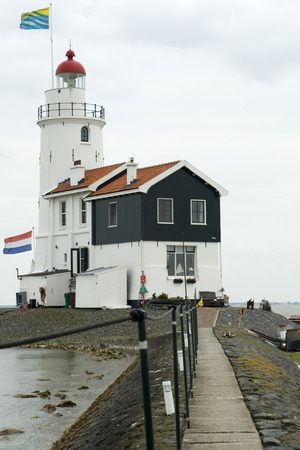 marken: lighthouse with flag from country and provincial Stock Photo