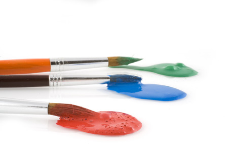 brushes with green, blue and red paint Stock Photo