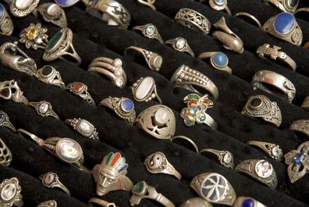 threaded: many silver rings on black velvet