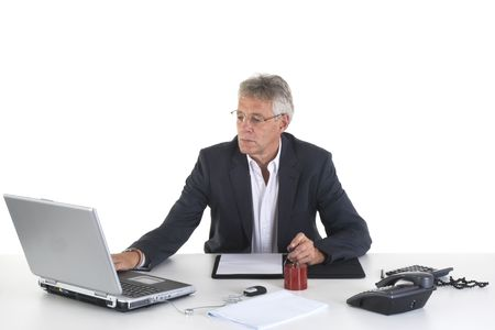 senior working at the office with laptop photo