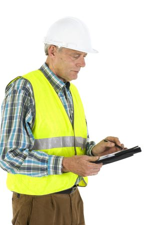 overseer: writing while visiting the workplace with safety helmet and safety jacket