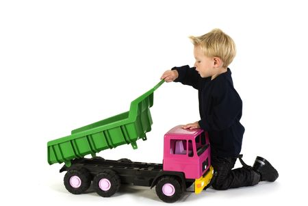 Little boy is playing with heavy truck photo