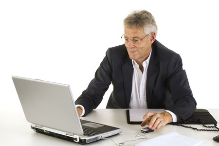 senior business man working with laptop photo