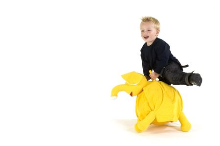 Little boy has fun with a yellow elephant Stock Photo - 1896317
