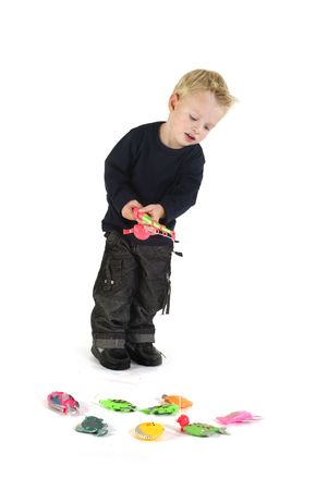 little blond child is fishing very concentrating