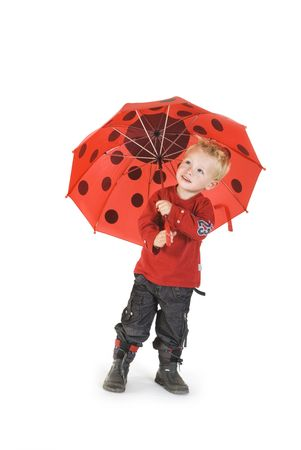 rainy day for the little boy with his umbrella photo