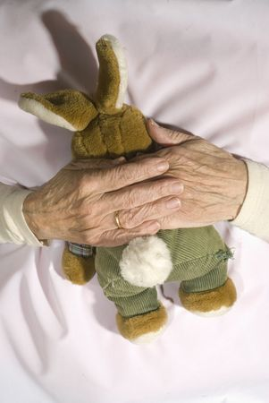 demented: Old demented person with stuffed rabbit