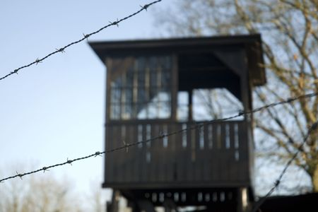 correctional officer: watch-tower behind fence in jail Stock Photo