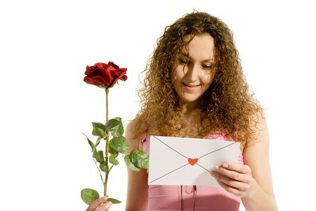 attractive girl with Valentine card or loveletter photo