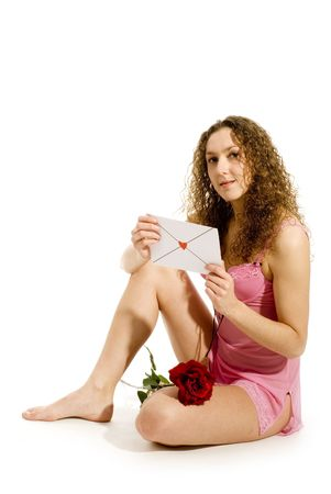 attratctive girl with Valentines card and red rose Stock Photo - 2412608