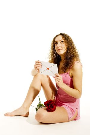 Girl with loveletter is looking heavenly Stock Photo - 2427891