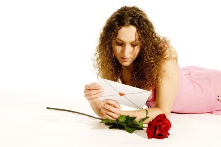 lovely young girl is lay down with loveletter and rose photo