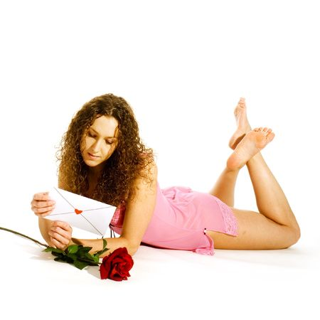 girl in love with loveletter and red rose photo