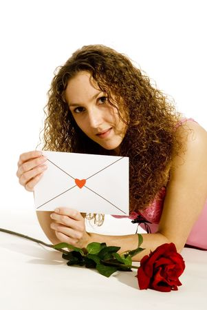 young girl in love with loveletter and red rose photo