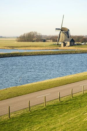 Dutch landscapw with windmill Stock Photo - 2589817