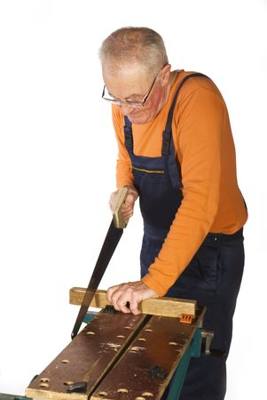 worktable: construction man is sawing the wood