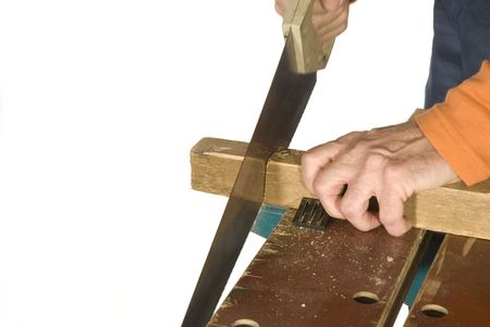 sawing: sawing the wood for a construction