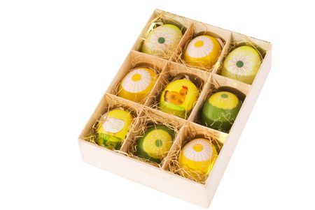 wooden box with colored easter eggs photo