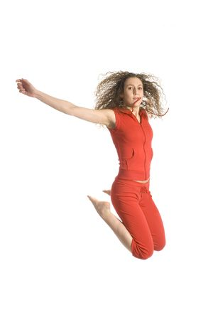 jumping high by a attractive girl in red photo