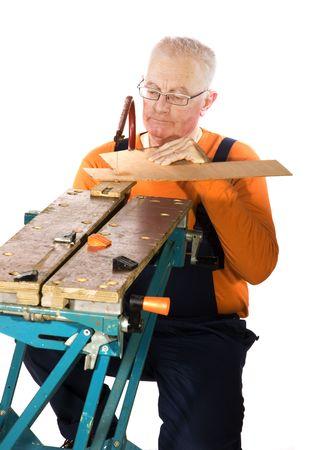jig: construction man is jig sawing Stock Photo