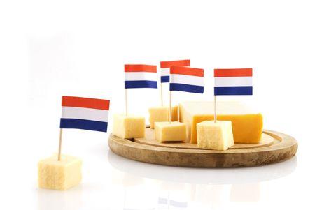 cubes Dutch cheese with Dutch flag photo