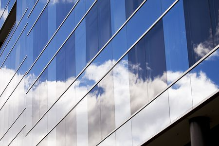 clouds reflected in glass from skyscraper  photo