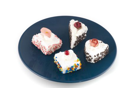 fancy cakes with cream and colored speckles photo
