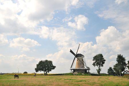Dutch windmill in landscape photo