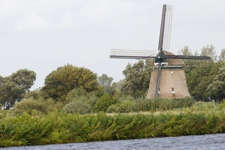 Windmill in Dutch landscape near the river Stock Photo - 3455432