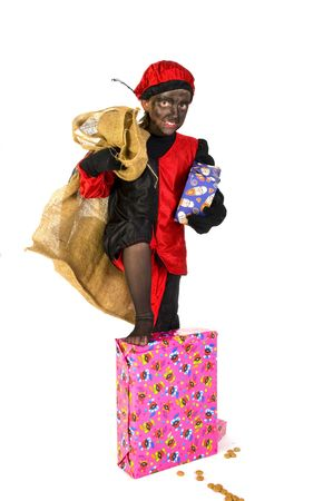 Child as Black Piet with bag and presents Stock Photo - 3823827
