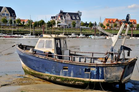 Damaged boat in Normandy the village Crotoy photo