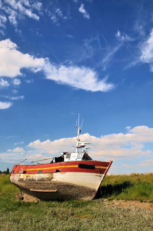 Damaged boat at the coast from Normandy photo