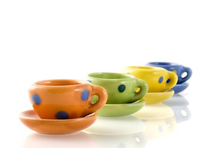 earthwork: a row of colorful cups and saucers with dots