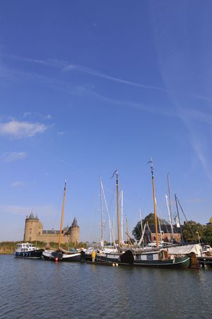 Castle and harbor in Holland Stock Photo - 3912396