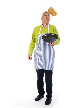 Elderly man is baking pancakes Stock Photo - 3936354