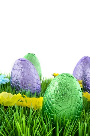 Wrapped chocolate easter eggs in the grass photo