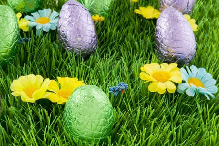 Chocolate easter eggs in the grass photo